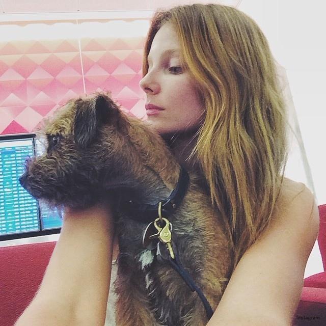 Eniko Mihalik poses with dog