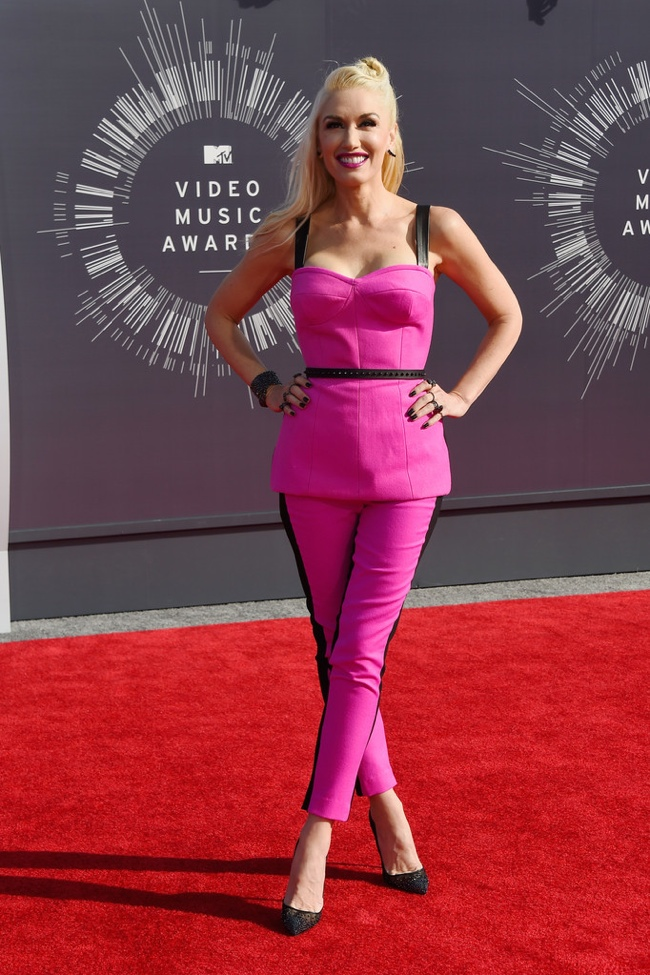 Gwen Stefani wears pink and black pant look
