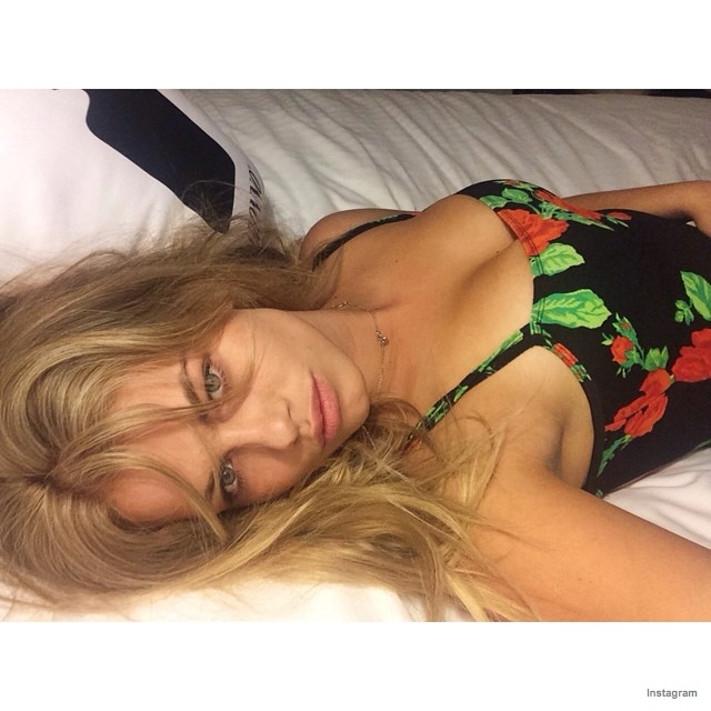 Hailey Clauson takes a photo in bed