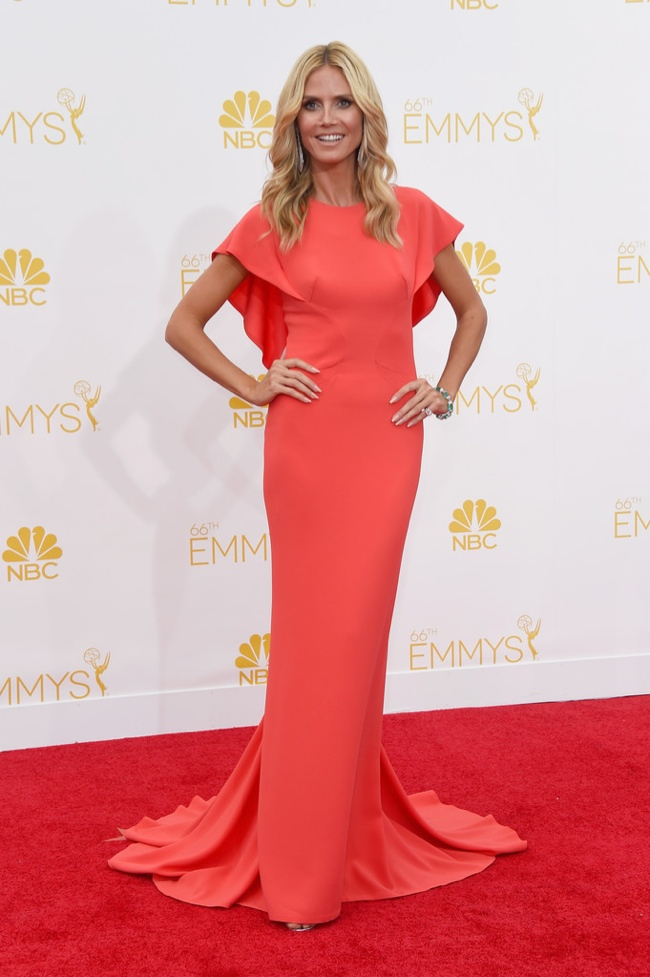 Model Heidi Klum sported a Zac Posen resort 2015 coral-colored dress