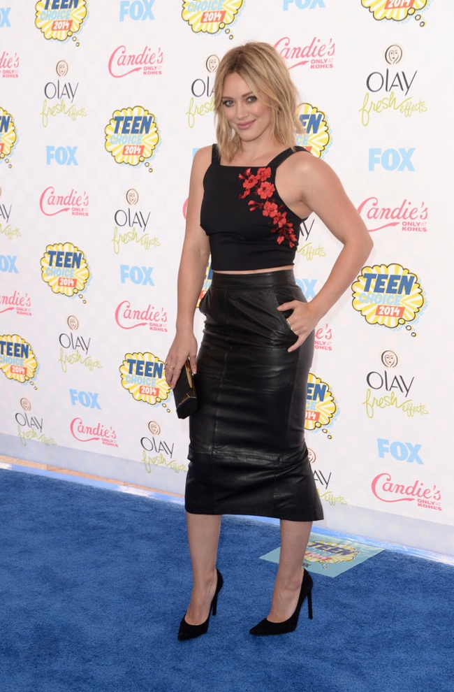 Hilary Duff hits the blue carpet in a leather skirt and black crop top