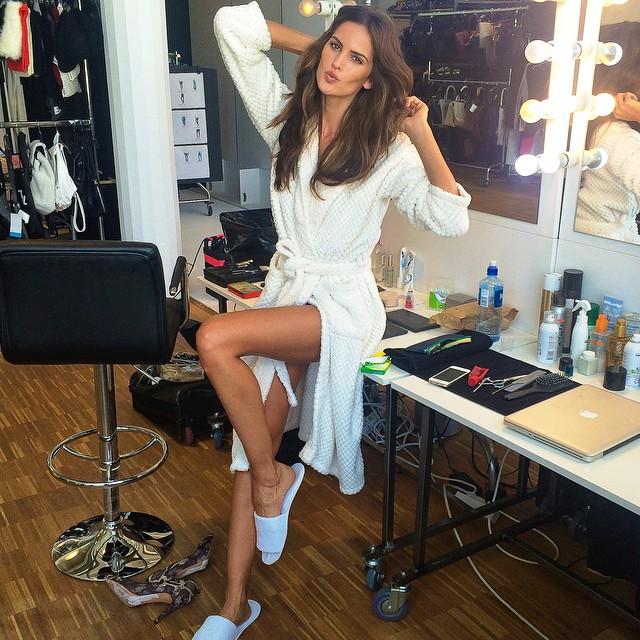 Izabel Goulart models robe on H&M set