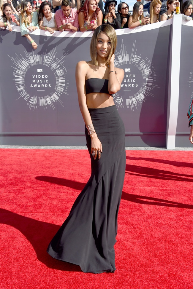 Jourdan Dunn dons a black crop top and skirt ensemble from Balmain