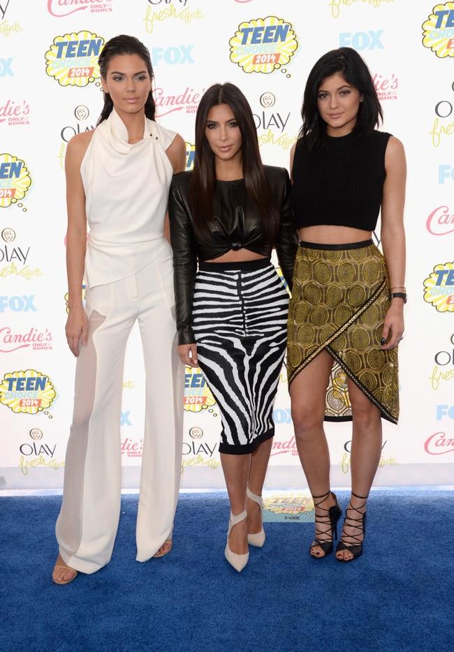 Kendall Jenner, Kim Kardashian (wearing Balmain) and Kylie Jenner