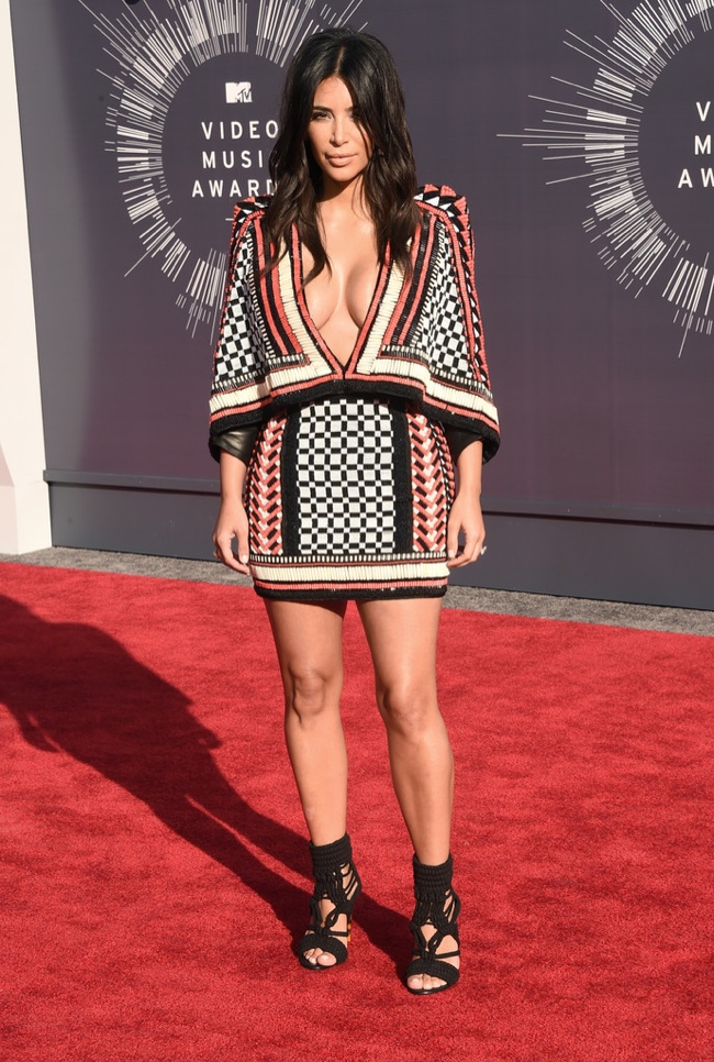 Kim Kardashian in short and graphic print Balmain dress