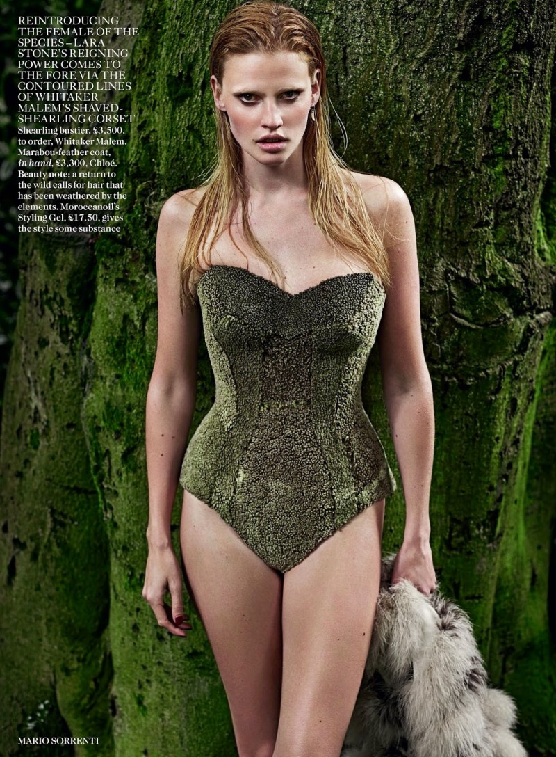 lara vogue uk005 800x1088 Lara Stone Poses with Fur, Wolves for Vogue UK Shoot by Mario Sorrenti