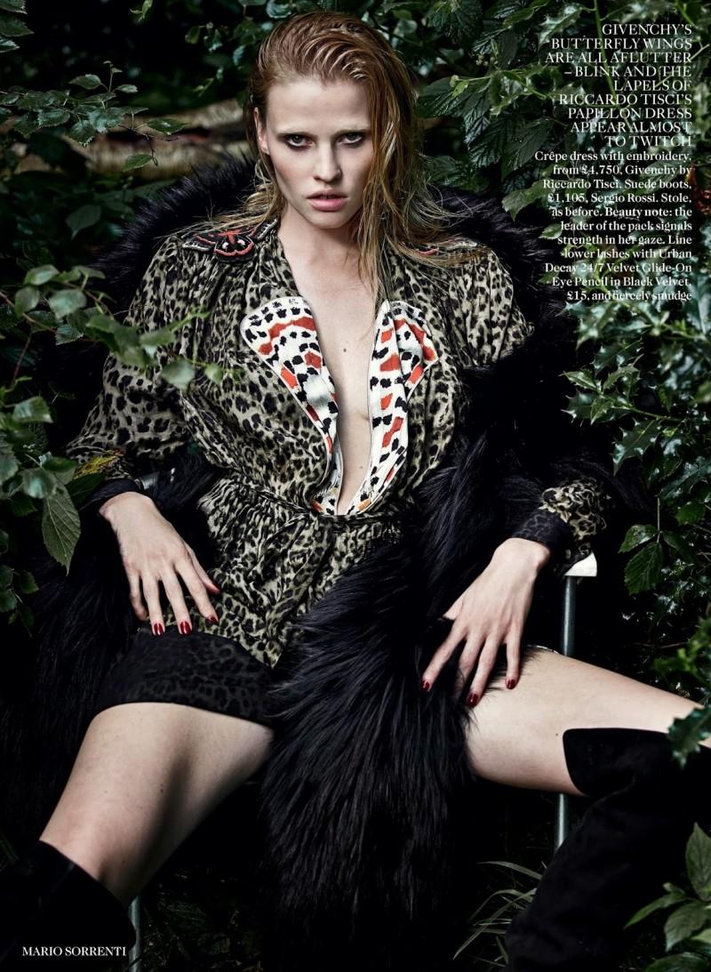 lara vogue uk008 800x1093 Lara Stone Poses with Fur, Wolves for Vogue UK Shoot by Mario Sorrenti