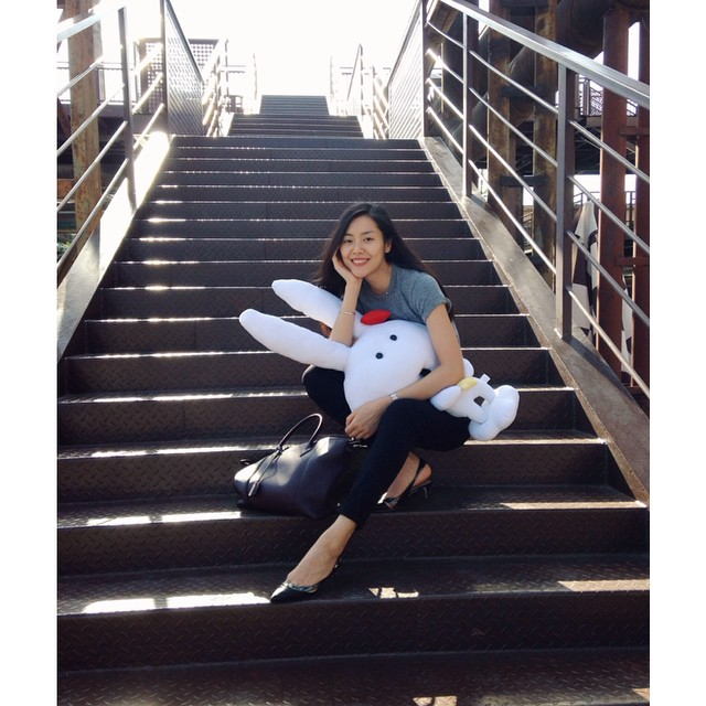Liu Wen poses on steps with a bunny