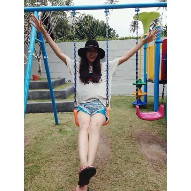 Liu Wen poses on swing
