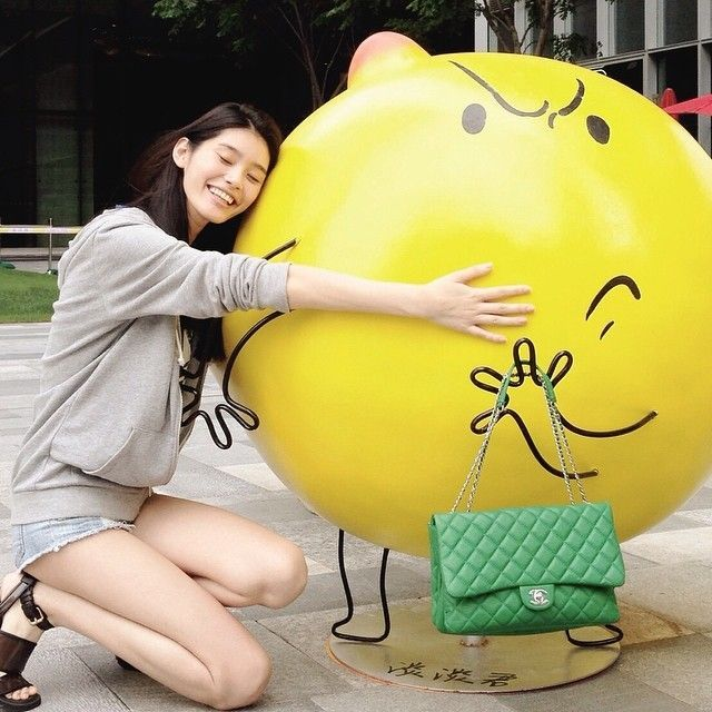 Ming Xi poses with giant lemon