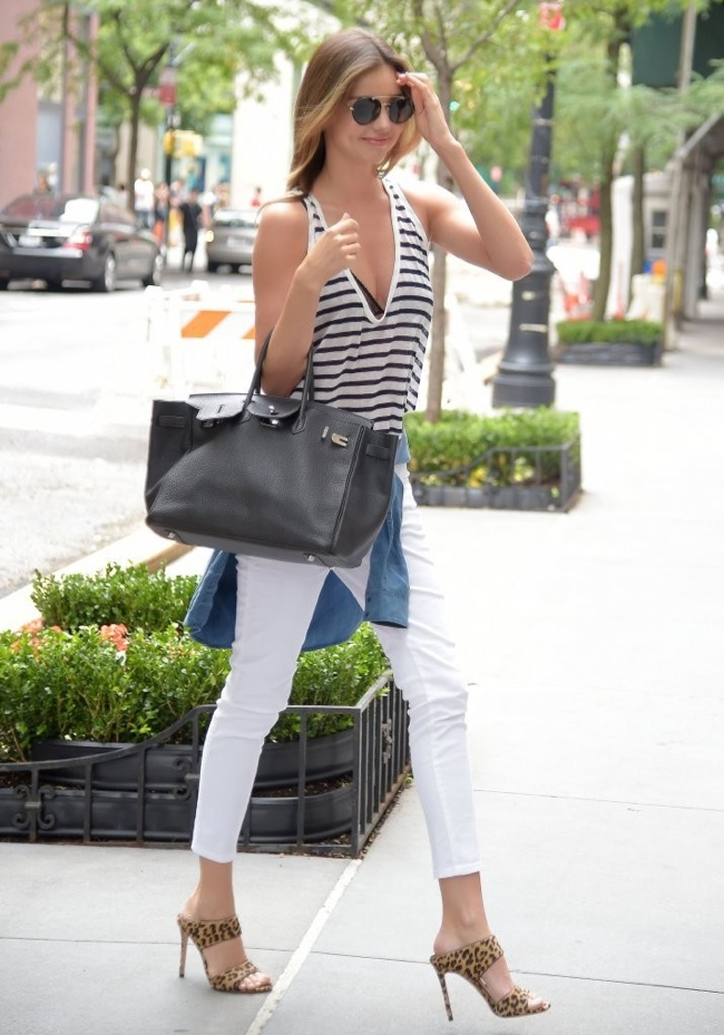 Miranda Kerr was spotted out an about in New York this past month wearing a striped v-neck tank paired with white denim and a denim jacket tied around her waist.