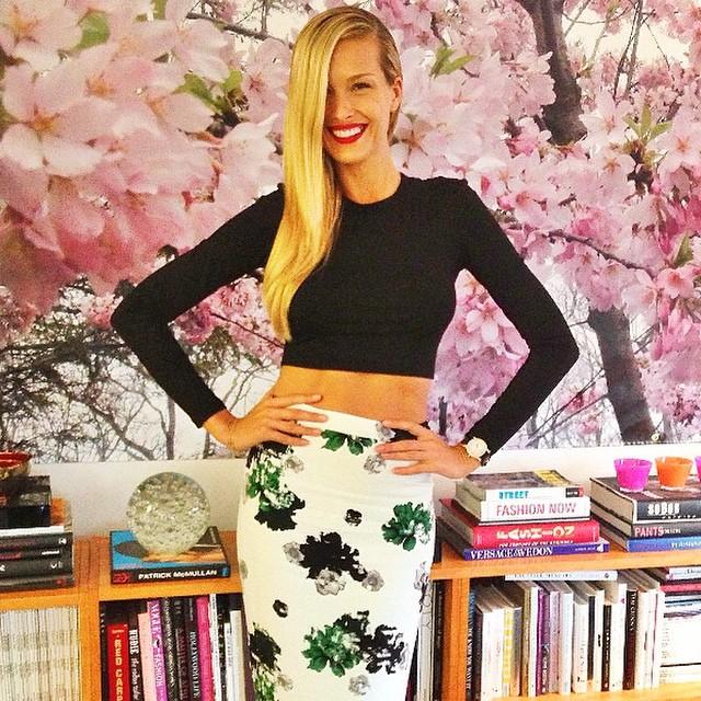 Petra Nemcova wears crop top and high-waisted skirt