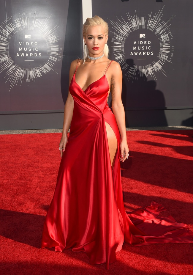 Rita Ora wears high-slit red dress from Donna Karan