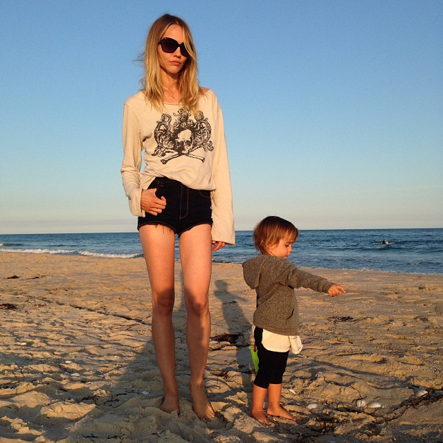 Sasha Pivovarova poses in the Hamptons with her daughter