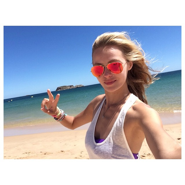 Valentina Zelyaeva in sunglasses at the beach