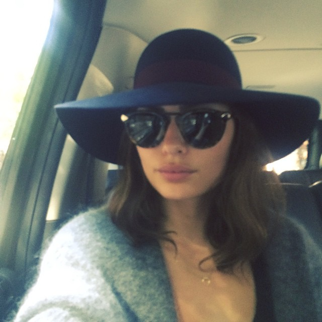 Alyssa Miller looks chic in glasses and hat