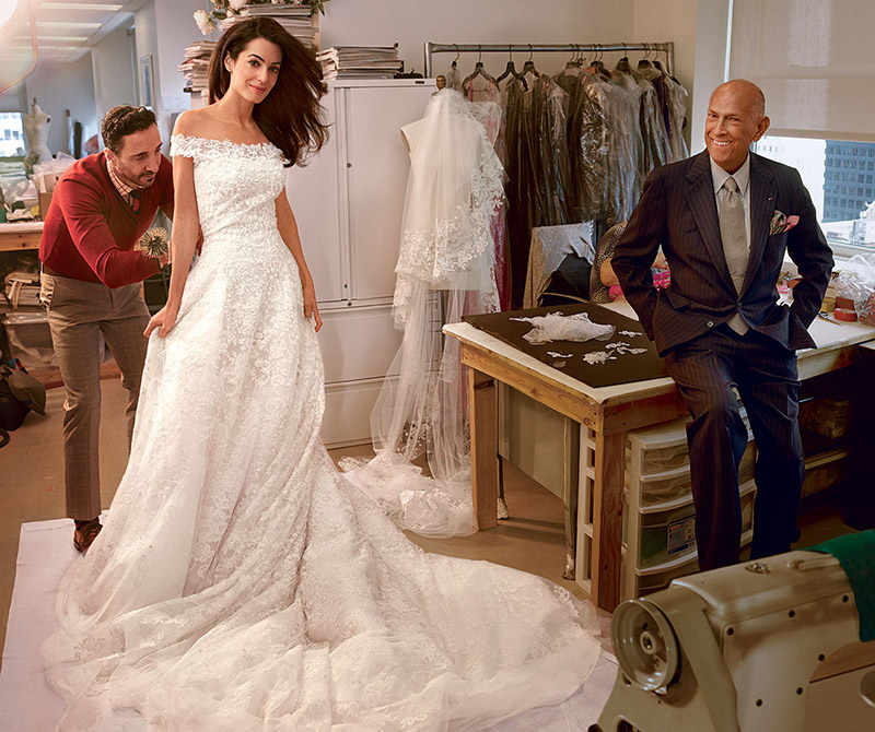 Amal Alamuddin at final fitting with designer Oscar de la Renta (right) and head tailor Raffaele Ilardo. Photographed by Annie Leibovitz for Vogue US