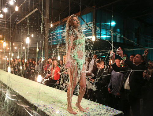 The contestants had to walk the runway while wearing silly string