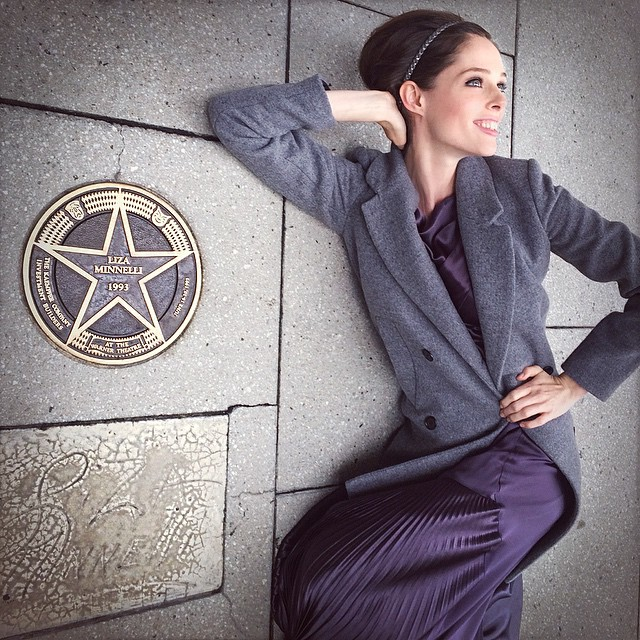 Coco Rocha poses next to Liza Minelli's star on Hollywood Walk of Fame