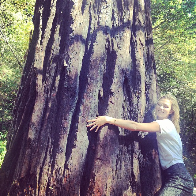 Karlie Kloss is a tree hugger (literally)