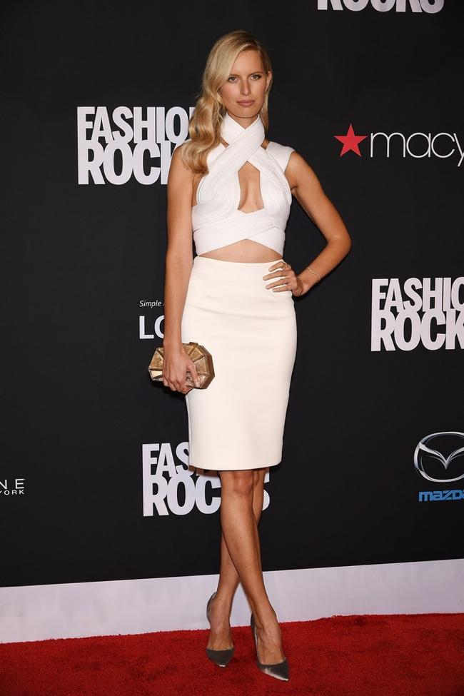 Karolina Kurkova donned a matching white top and skirt look
