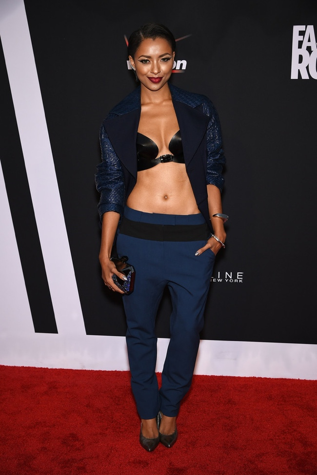 Kat Graham rocked a blue pantsuit with a black bra