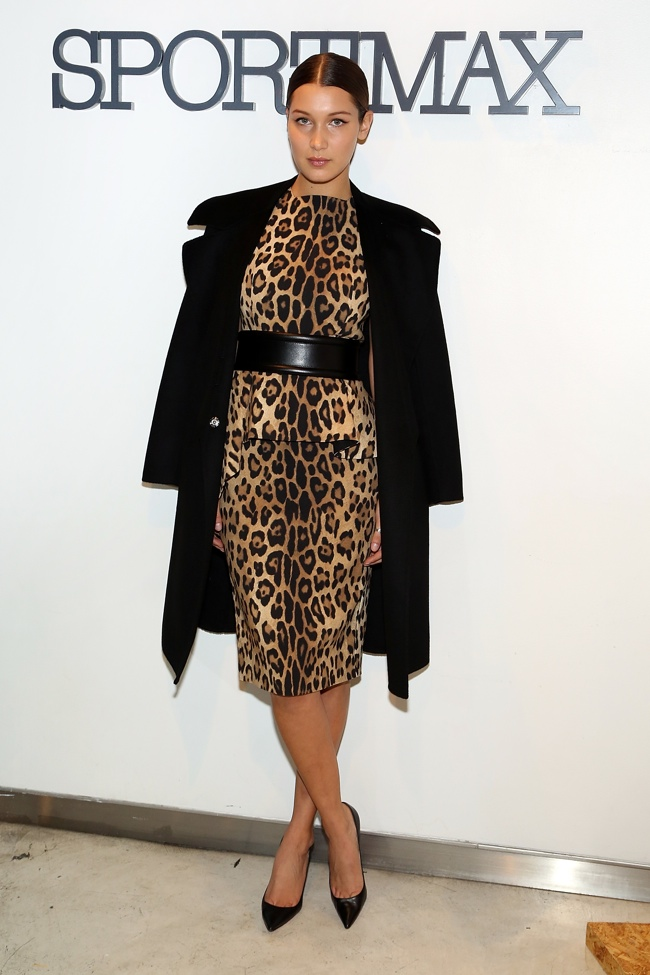 Bella Hadid wears Sportmax Silk Jersey Leopard Print Dress with Peplum, Black Leather Belt and Black Cashmere Coat