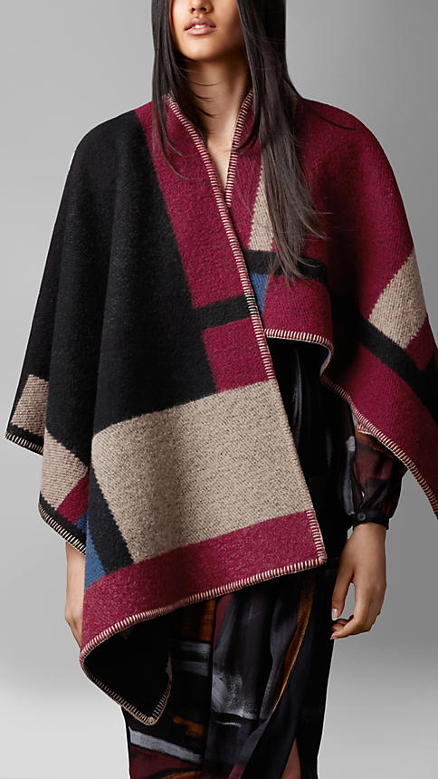 The Burberry color-block check blanket poncho sells for $1,395 on Burberry.com.