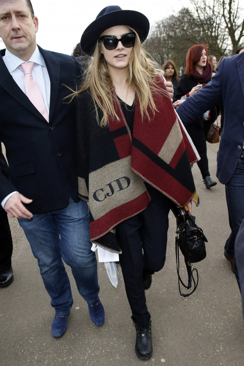 Cara Delevingne wears Burberry monogrammed poncho in London. Photo: FilmMagic
