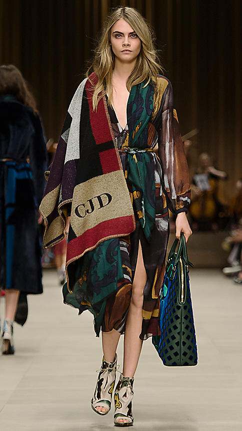 Cara Delevingne wears Burberry poncho at fall 2014 runway show