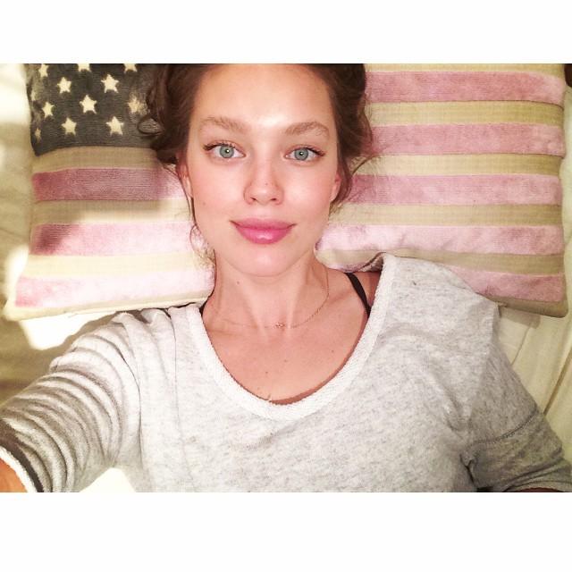 Emily DiDoanto poses with USA flag pillow
