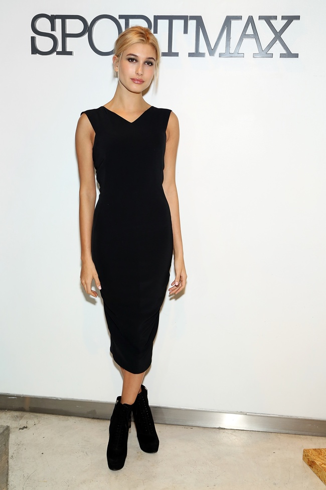 Hailey Baldwin wears Sportmax Black Silk Jersey Sleeveless Dress