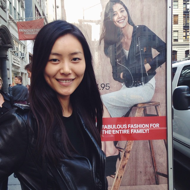 Liu Wen poses with her H&M ad