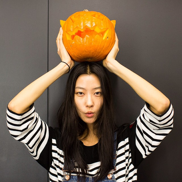 Ji Hye Park with a carved pumpkin