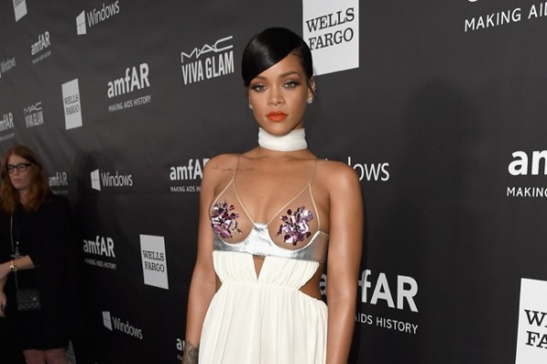 Rihanna wears Tom Ford pasties with white skirt