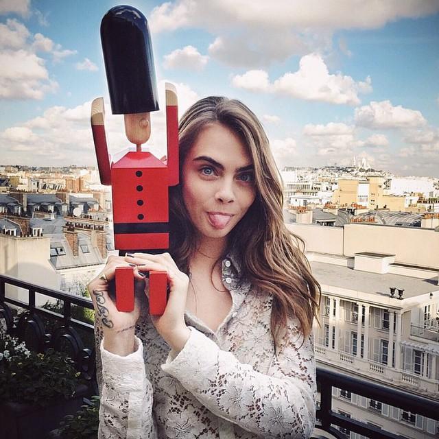 Cara Delevingne poses with nutcracker in Paris