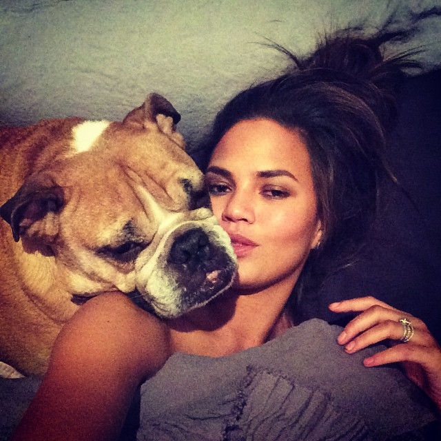 Chrissy Teigen poses with her dog