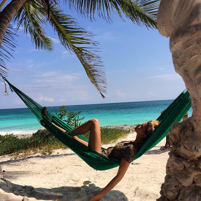Hailey Clauson relaxes at the beach