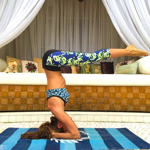 Izabel Goulart does a crazy headstand