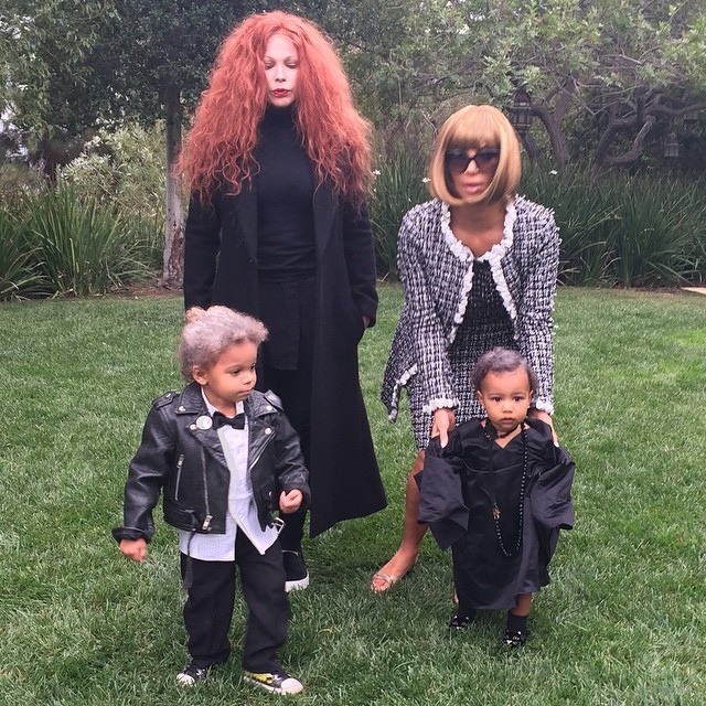 Kim Kardashian dressed as Anna Wintour for Halloween. Her daughter North was Andre Leon Talley with a mini Karl Lagerfeld, and Grace Coddington