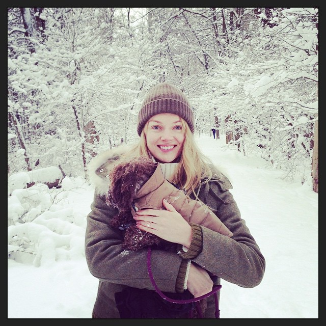 Lindsay Ellingson in the snow with her dog