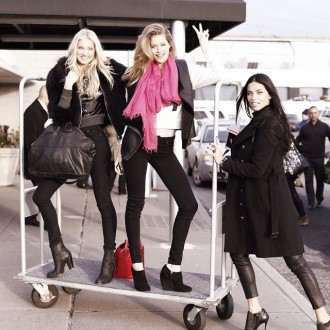 Elsa Hosk, Doutzen Kroes and Adriana Lima has some fun with the luggage carrier