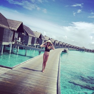 Chrissy Teigen poses in swimsuit while on vacation in the Maldives