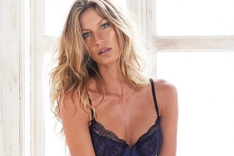 ALL DOLLED UP: Gisele Bundchen poses in a Gisele Intimates show with a bronzed glow and face of makeup.