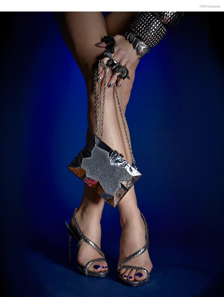 Tom Ford Sandals, Emm Kuo Wooden Clutch, Noir Pegasus (On Ring Finger), Kenneth Jay Lane (Middle & Ring Finger), Diesel Black Quartz (On Thumb), Giles & Bro Fishtail Bracelet, Lee Angel Studded Cuffs, Nails 'Hello & Goodbye' by Caption