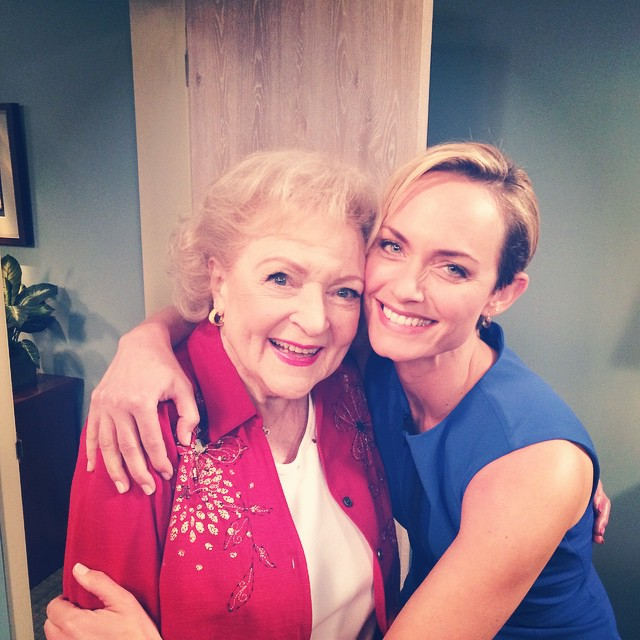 Amber Valletta takes a photograph with Betty White