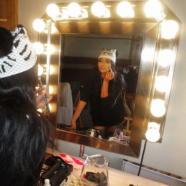 Chanel Iman puts the final touches on her beauty look