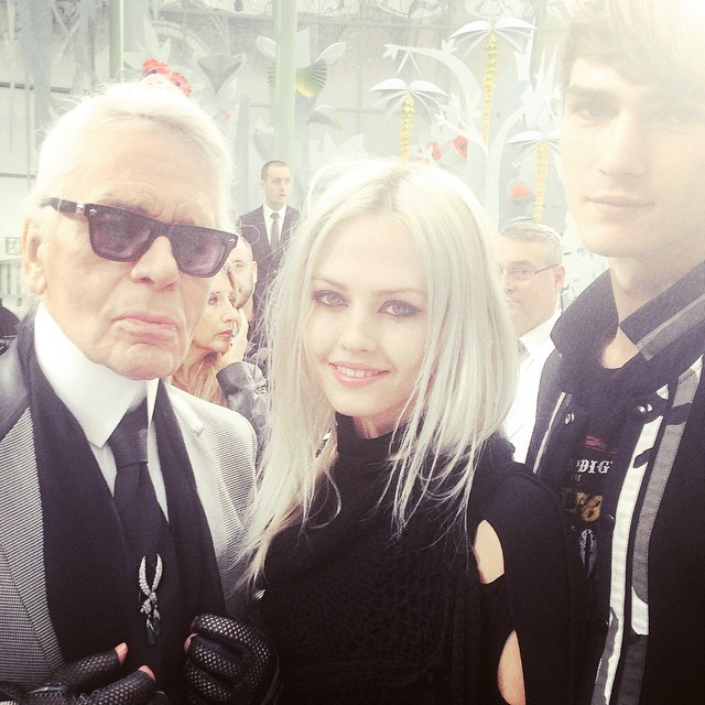 Charlotte Free poses with Karl Lagerfeld at the Chanel Haute Couture show