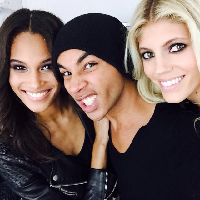 Models Cindy Bruna and Devon Windsor pose with Balmain creative director Olivier Rousteing