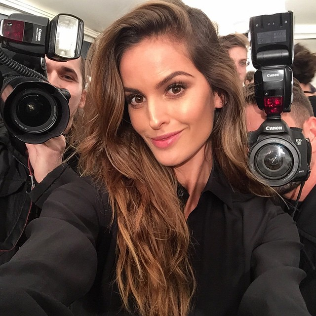 Izabel Goulart gets surrounded by cameras backstage at a DSquared2 show
